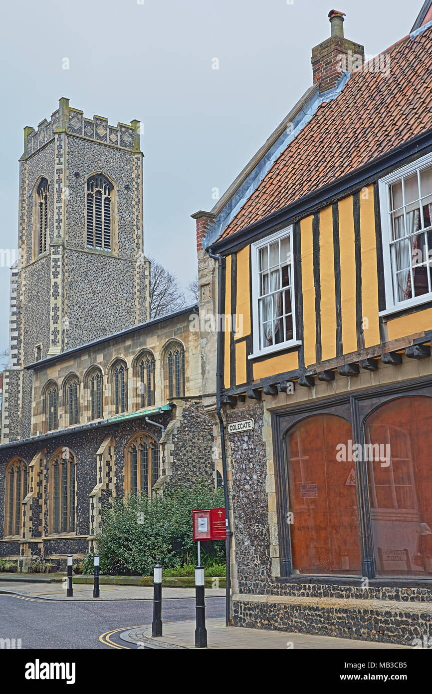 NORWICH, UK - MARCH 30, 2018: A timbered framed House (located on Colegate and built by Henry Bacon in 16th Century) with St George Colegate Church Stock Photo