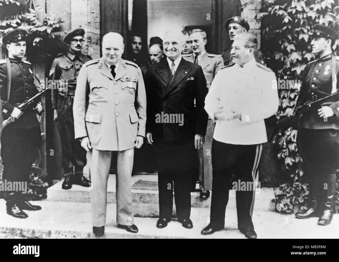 Winston Churchill, President Harry S. truman, and Joseph Stalin, at the Potsdam Conference of 1945.The Potsdam Conference was held at Cecilienhof, the home of Crown Prince Wilhelm, in Potsdam, occupied Germany, from 17 July to 2 August 1945. In some older documents it is also referred to as the Berlin Conference of the Three Heads of Government of the USSR, USA and UK. The participants were the Soviet Union, the United Kingdom, and the United States, represented by Communist Party General Secretary Joseph Stalin, Prime Minister Winston Churchill and, US President Harry S. Truman. - Stock Image