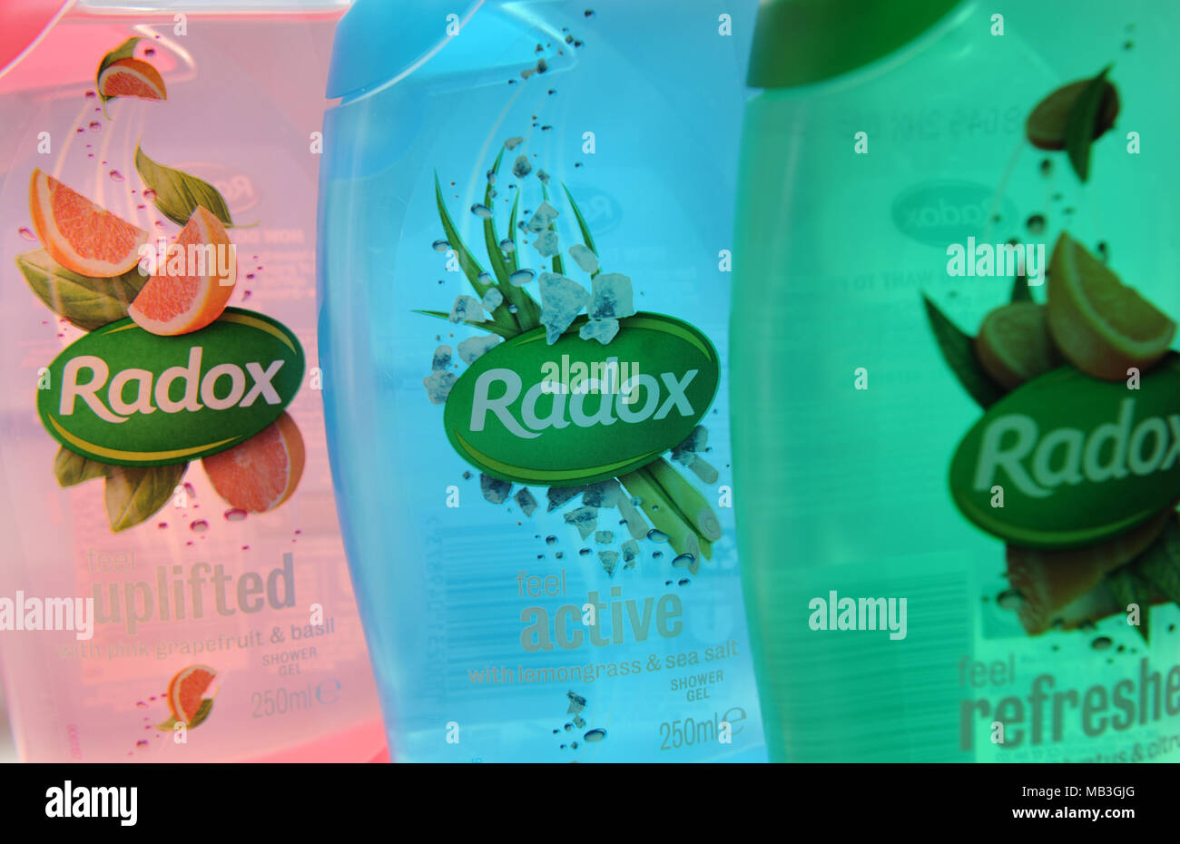 Radox toiletries lined up in a bathroom - Stock Image