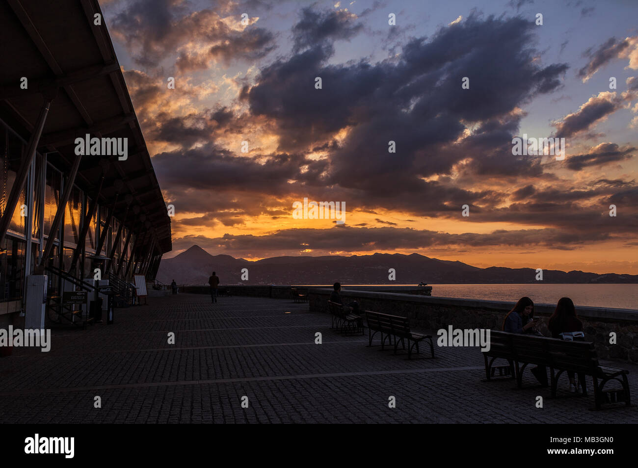 A great fiery sunset at Heraklion port - Stock Image