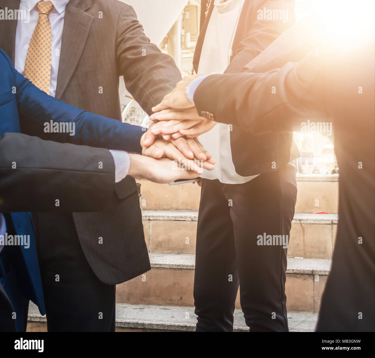Business teamwork join hands support together and dedicated Concept Stock Photo
