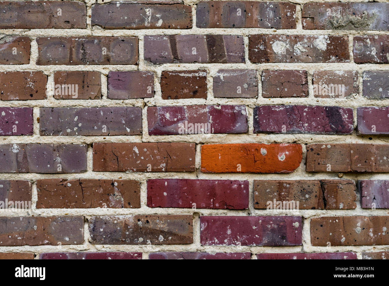 This brick has seen better days, but is still standing. - Stock Image