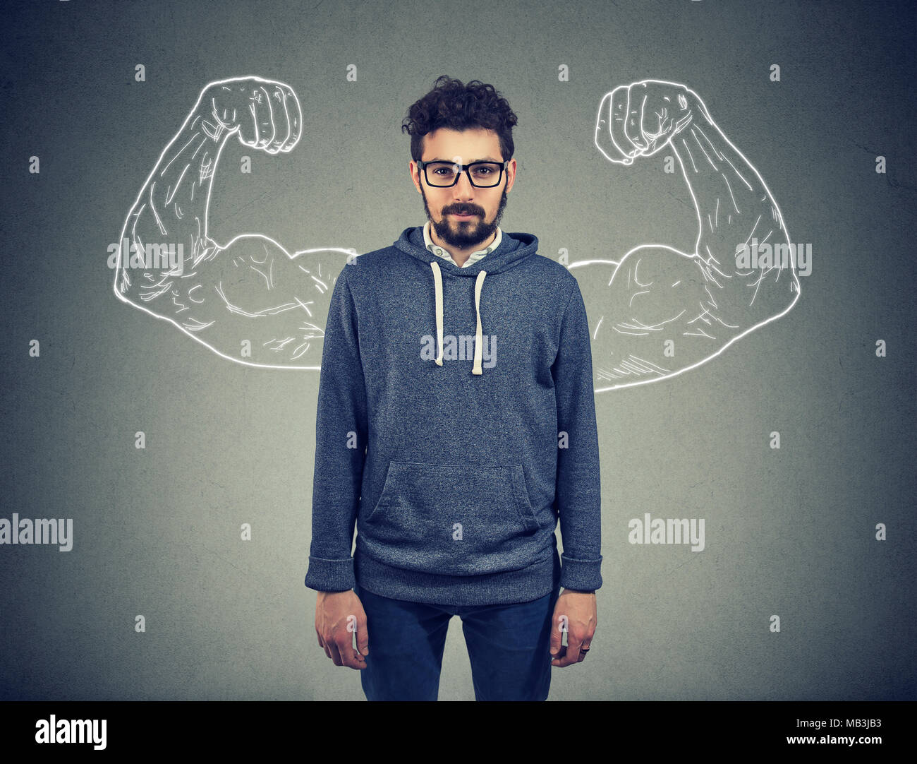 Strong confident young man hipster - Stock Image