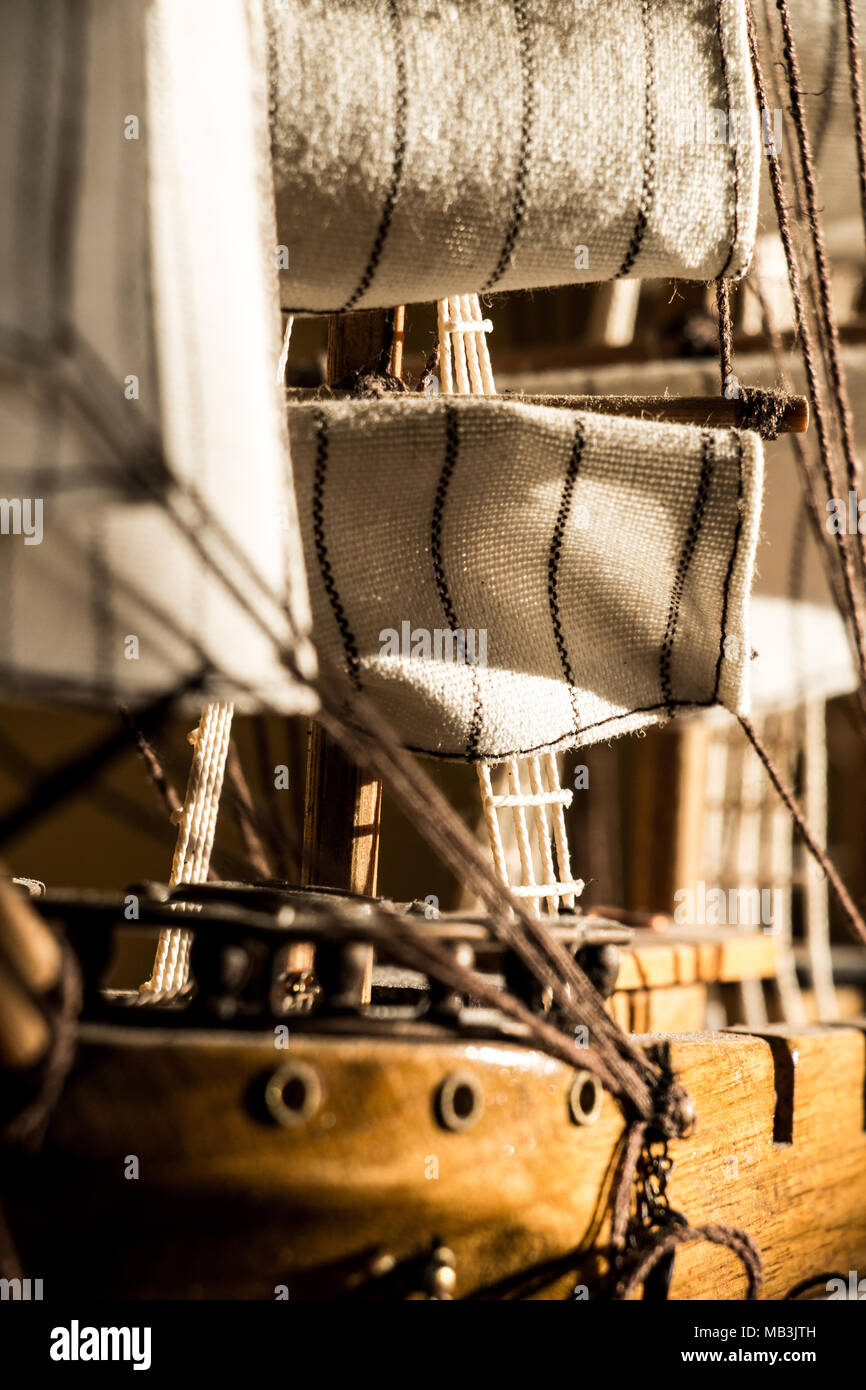 Vertical close up shot of a model wooden sail ship - Stock Image