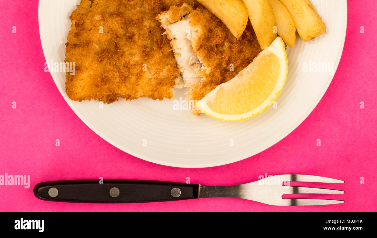 Traditional Popular Fish And Chips Against A Pink Backgound - Stock Image