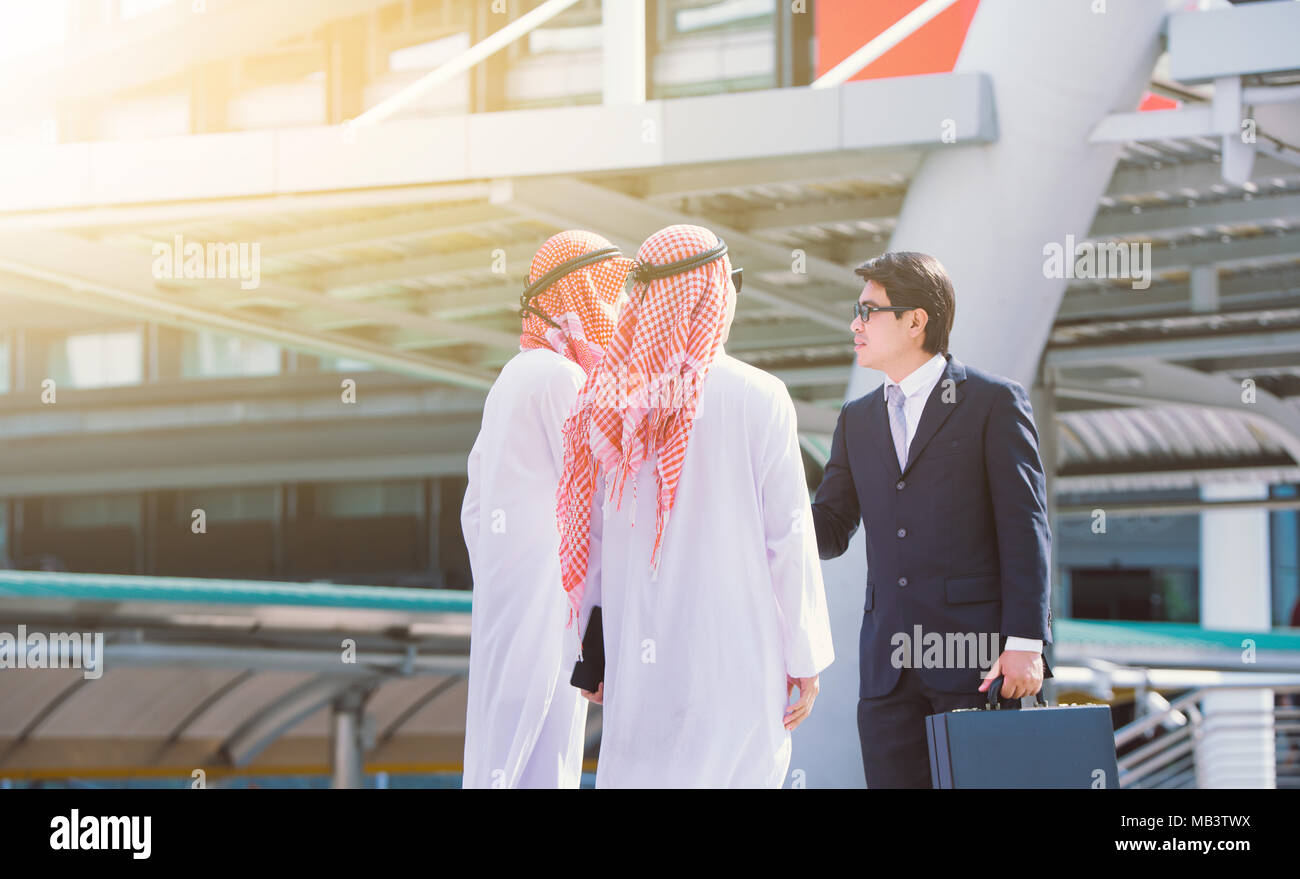 handshake concept.Arabic business and Businessman shaking hands - Stock Image