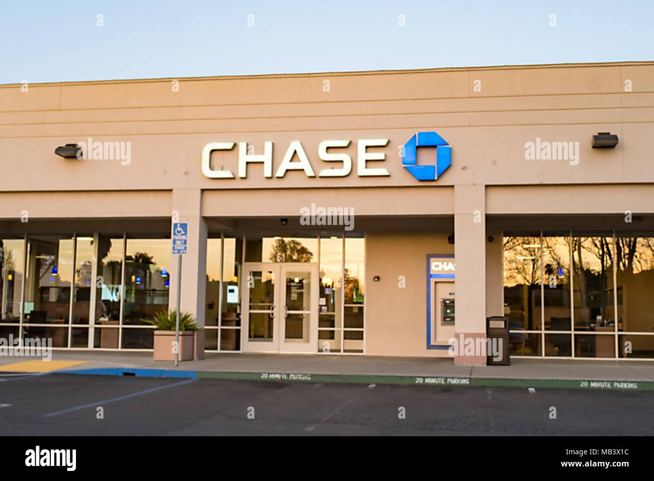 Dusk view of JP Morgan Chase bank branch with brightly lit ATM