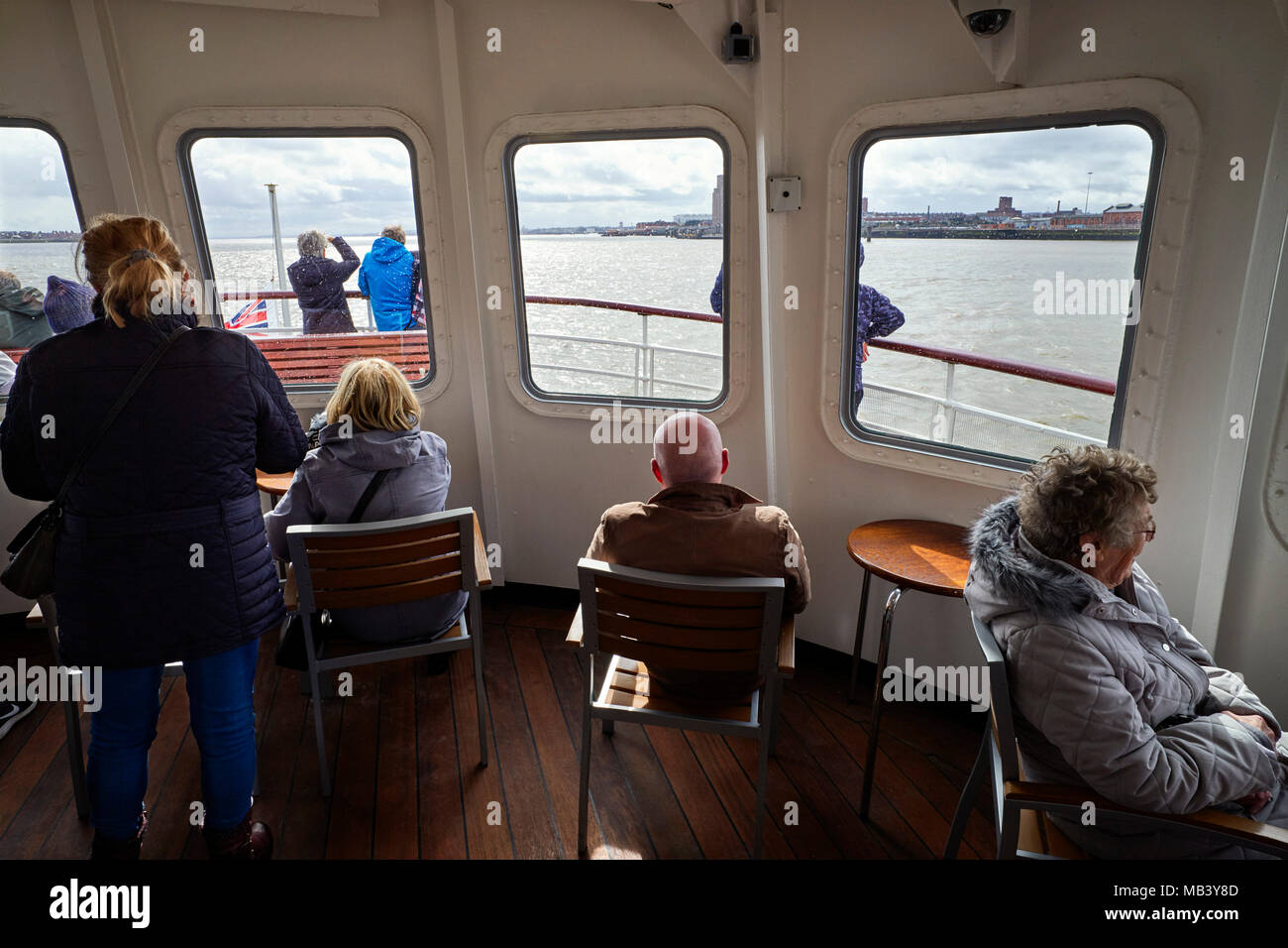 Passengers in the front lounge of the Mersey Ferry Royal Iris - Stock Image