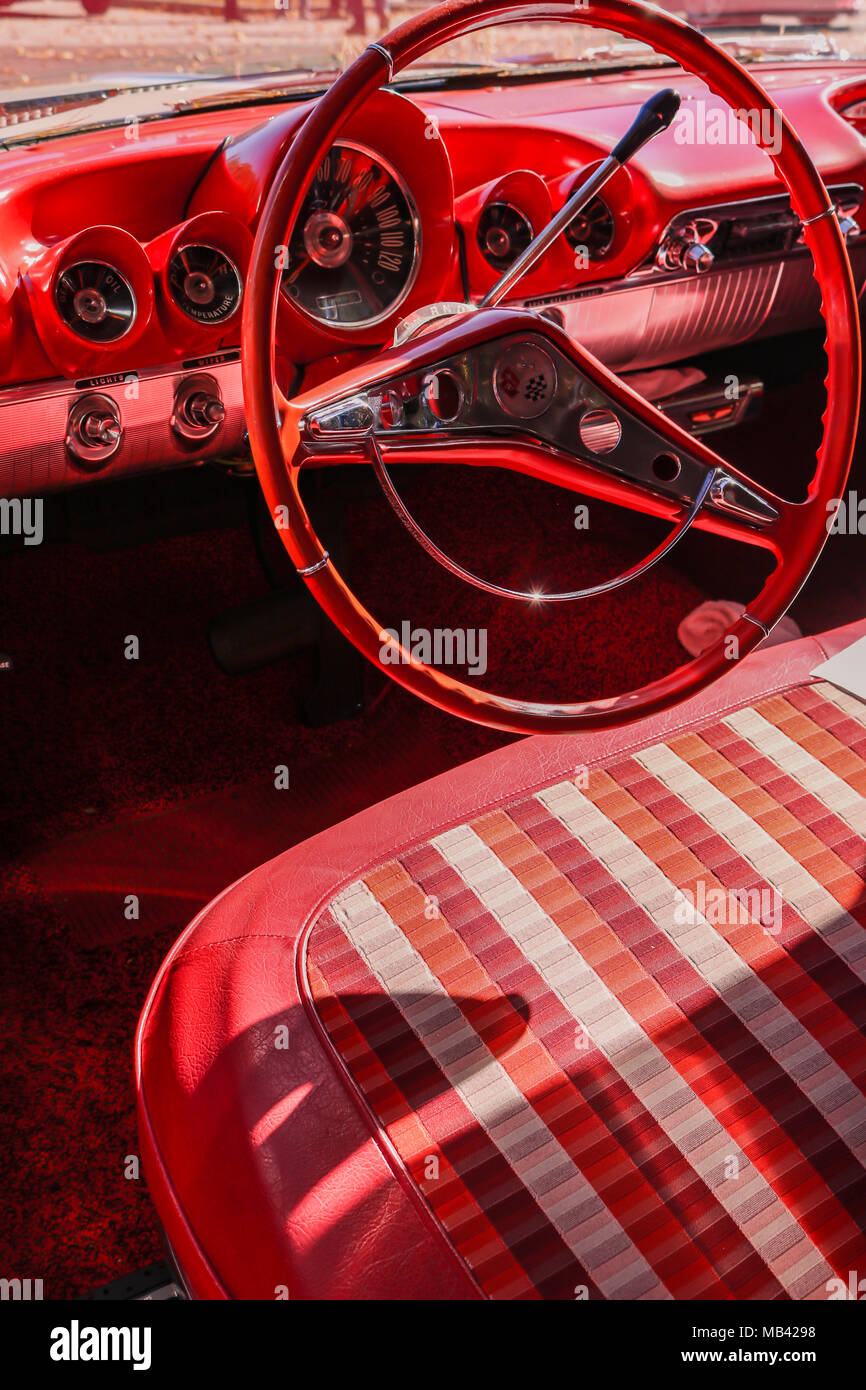Elegant red leather interior of a 1959 Chevrolet Impala