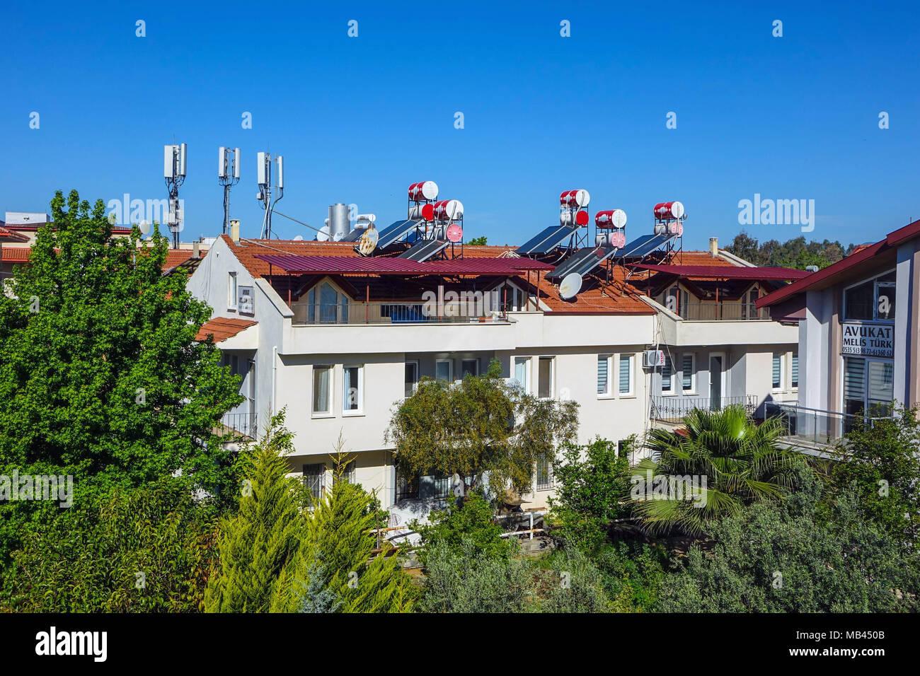 Mobile phone masts above rooftops, Fethiye, Turkey - Stock Image