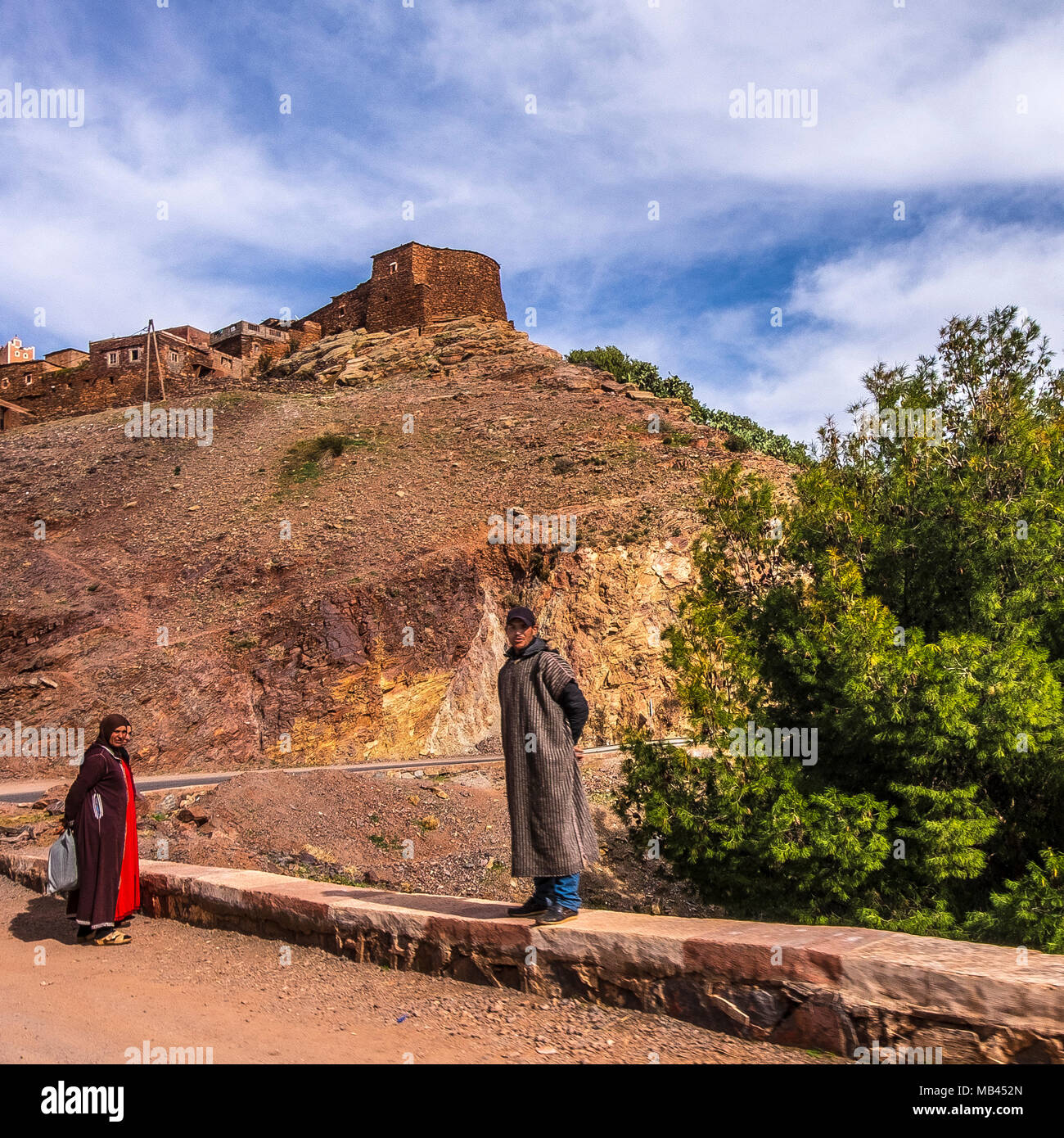 berbers by roadside in atlas mountains, morocco - Stock Image