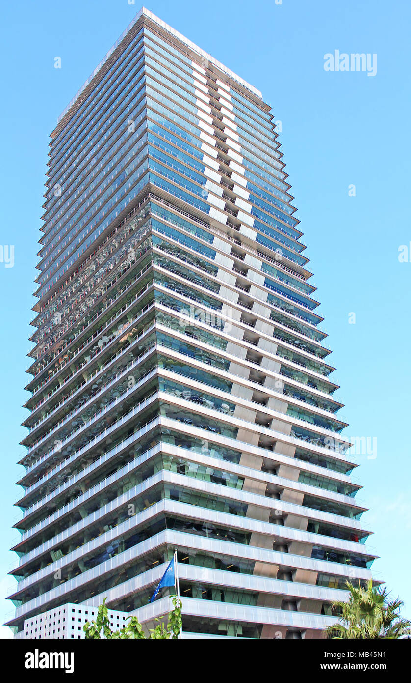 BARCELONA, SPAIN - OCTOBER 08: Torre Mapfre is a skyscraper in the Olympic Port, the maritime neighborhood of the Old City of Barcelona - Stock Image