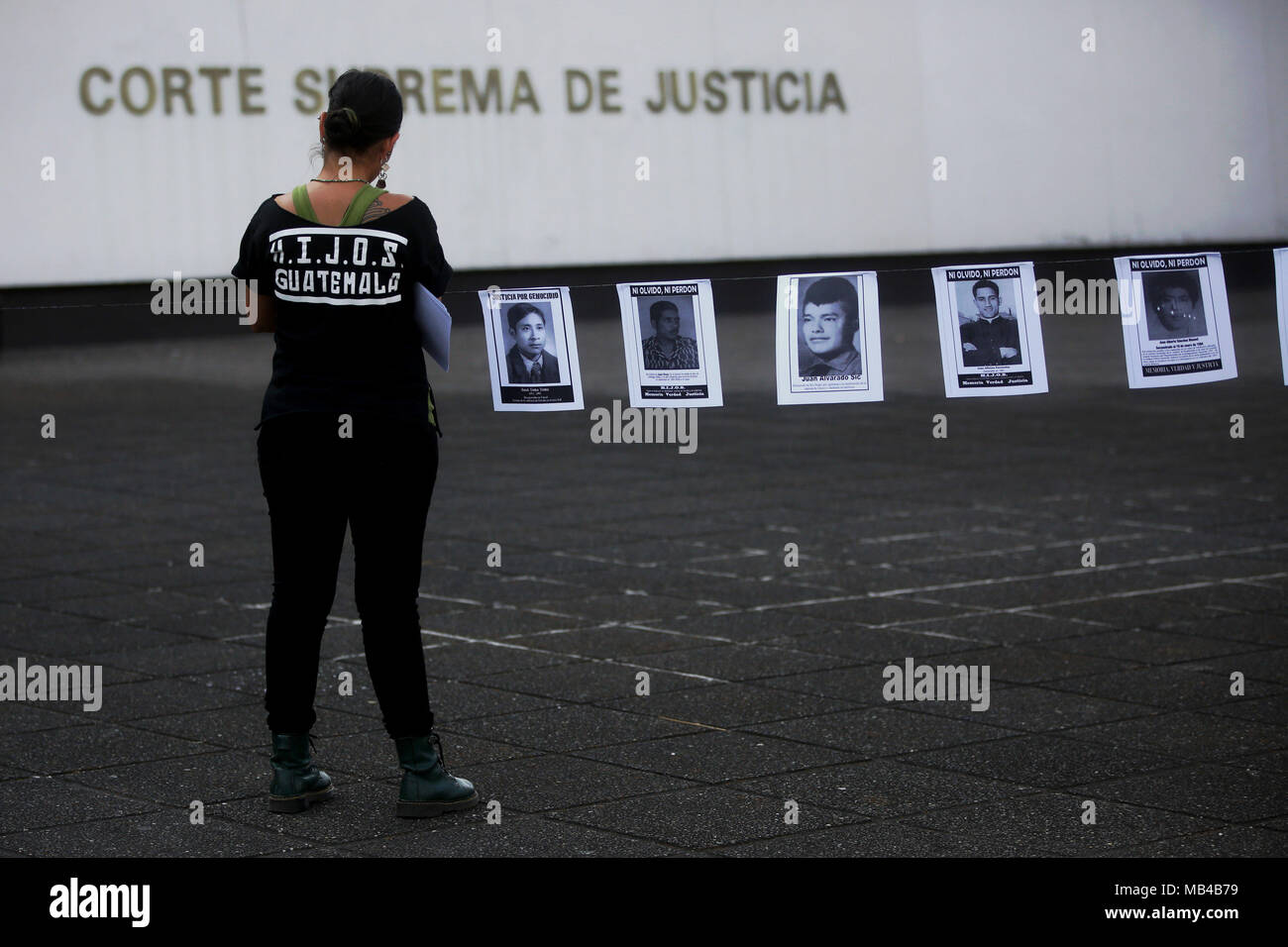 A view of portraits of victims of the dictatorship at an altar in Guatemala City, Guatemala, 06 April 2018. Civil organizations and relatives of the victims of the internal armed conflict during the government of Jose Efrain Rios Montt payed tribute to the victims of the ixil genocide at the Palace of Justice. The court in charge of the case decided to close the criminal process against the former dictator, who died past Sunday at the age of 91, and to give the families an economic compensarion of 67,567 dollars. EFE/Esteban Biba - Stock Image