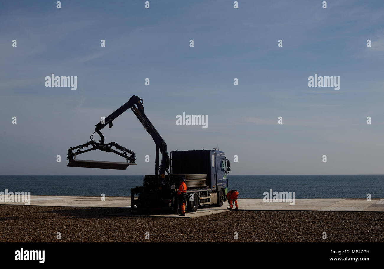 """Brighton, UK. 6th April 2018. Workmen install boards on Brighton Beach in East Sussex in preparation for the World Cup where the football will be televised live for the public to enjoy. Tourists and locals can enjoy the first England match on Monday 18th June from the beach. The big screen area run by Luna Beach Cinema will also be used to screen blockbusters on """"the highest definition LED screen in the country."""" Credit: Lauren Hurley/Alamy Live News Credit: Lauren Hurley/Alamy Live News Stock Photo"""