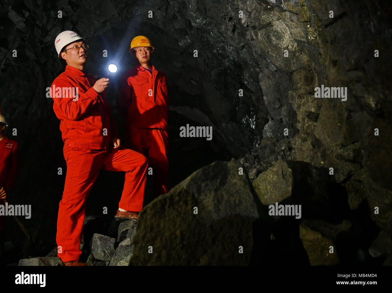 Lhasa, China's Tibet Autonomous Region. 7th Apr, 2018. Workers work at the construction site of the Galashan Tunnel in Lhasa, southwest China's Tibet Autonomous Region, April 7, 2018. The 4,373-km-long tunnel, about 3,600 meters of altitude, is part of the Lhasa to Nyingchi railway. Credit: Zhang Rufeng/Xinhua/Alamy Live News - Stock Image