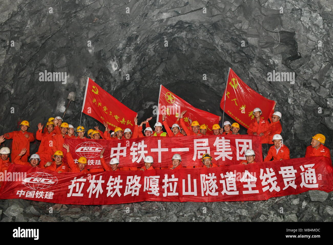 Lhasa, China's Tibet Autonomous Region. 7th Apr, 2018. Workers celebrate the holing-through at the construction site of the Galashan Tunnel in Lhasa, southwest China's Tibet Autonomous Region, April 7, 2018. The 4,373-km-long tunnel, about 3,600 meters of altitude, is part of the Lhasa to Nyingchi railway. Credit: Zhang Rufeng/Xinhua/Alamy Live News - Stock Image