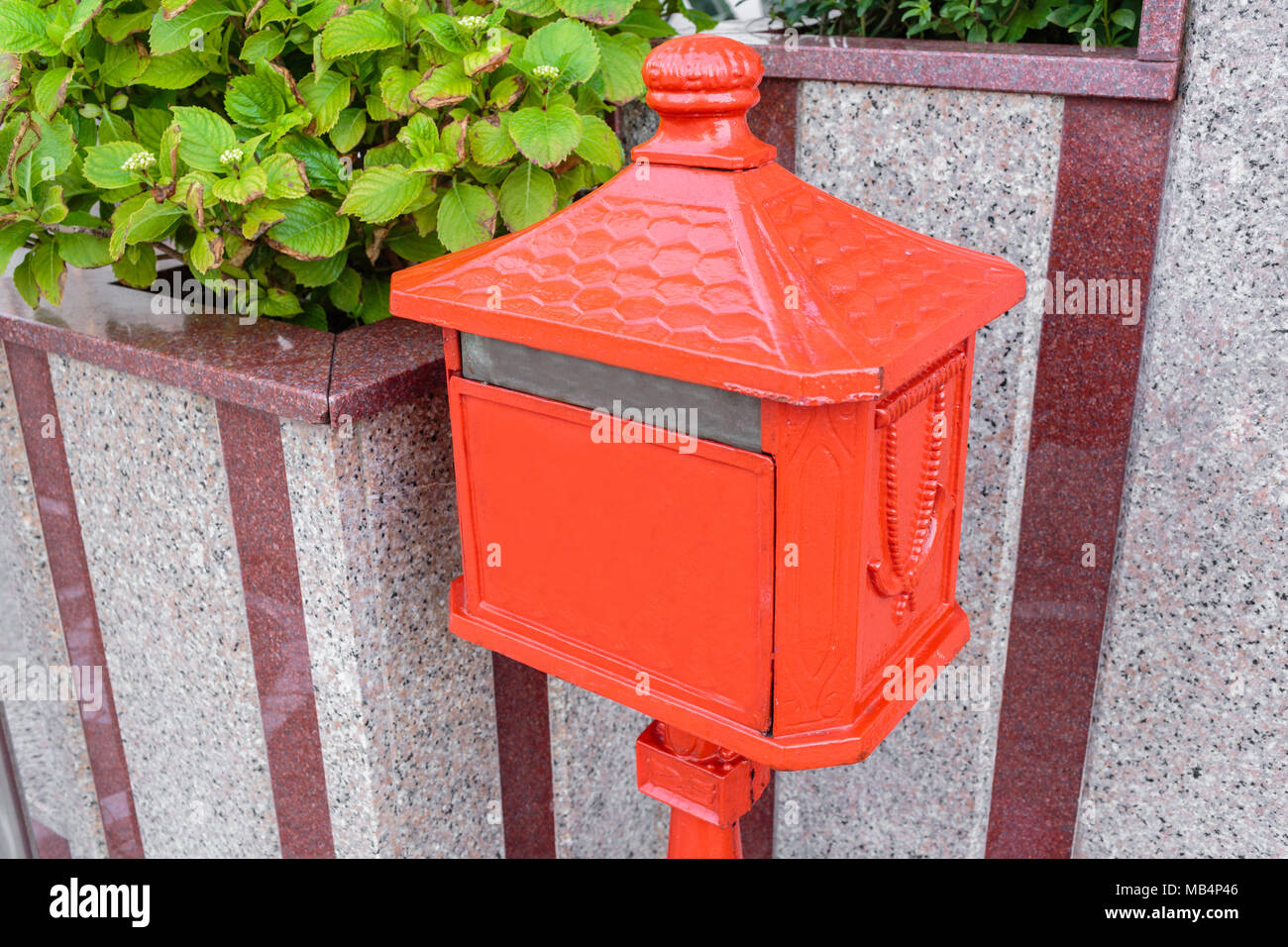 An old home letter box, red painted. Italy - Stock Image