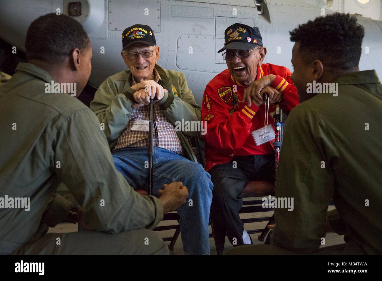 Len Maffioli and Damaso Sutis, two retired Marines and Iwo Jima veterans, share stories and laughs with active-duty Marines with Marine Medium Tiltrotor Squadron (VMM) 363 at Marine Corps Air Station Miramar, Calif., Feb. 16. This year marks the 73rd anniversary of the Battle of Iwo Jima, which began Feb. 19, 1945 and ended March 26, 1945. Stock Photo