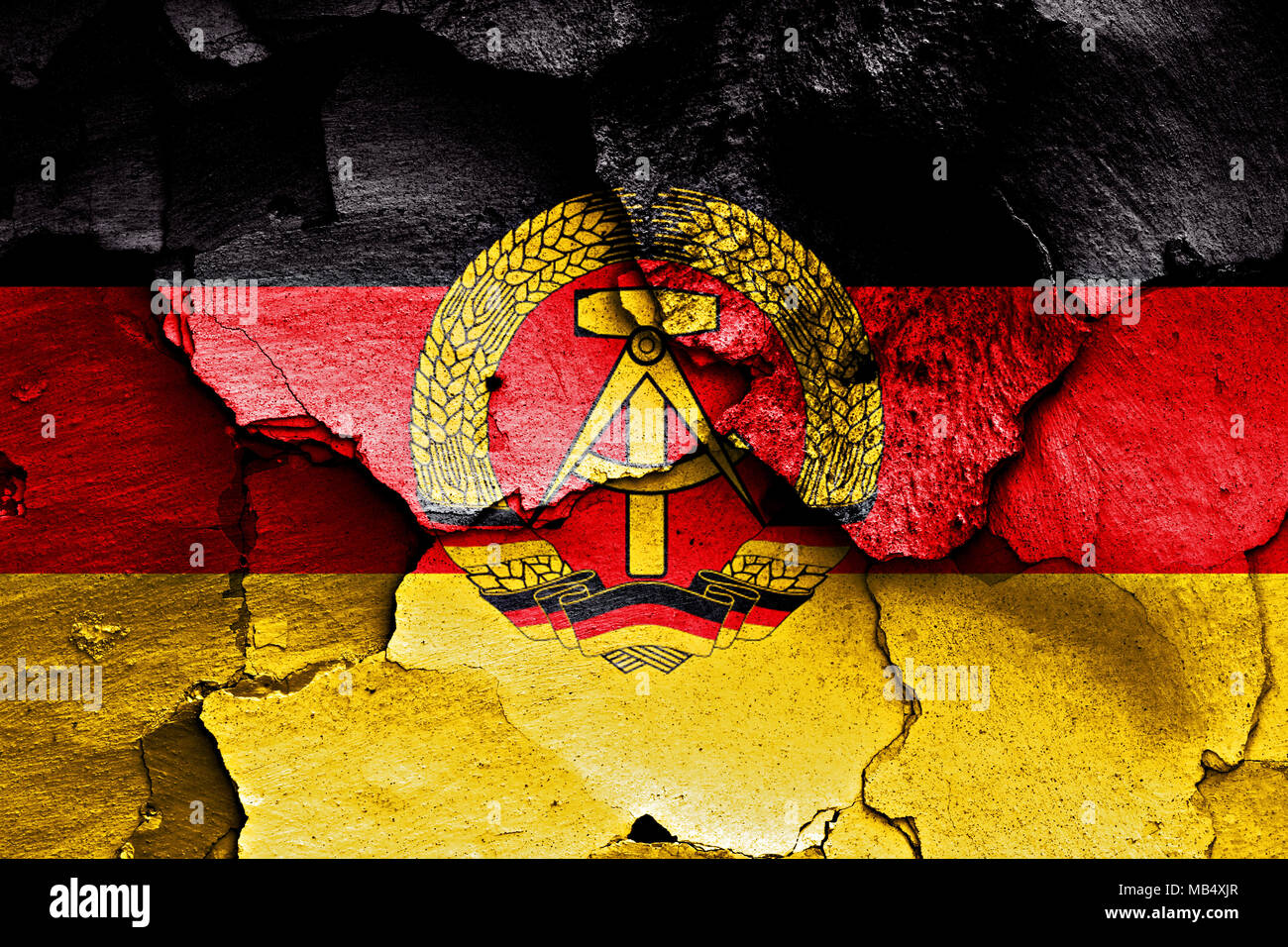 flag of East Germany painted on cracked wall - Stock Image