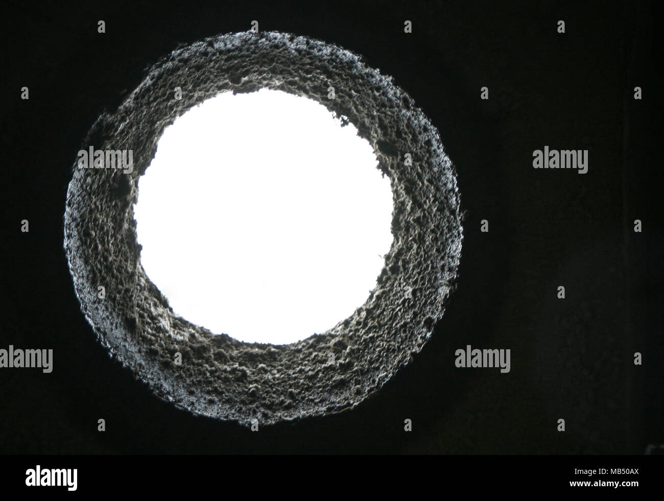 White sky hole from below the dark - Stock Image