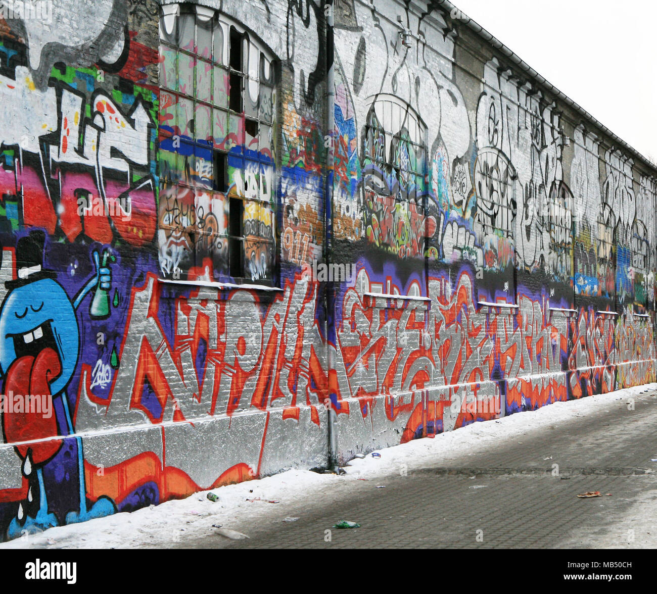 Colorful graffiti on the wall of an old factory, Copenhagen, Denmark - Stock Image