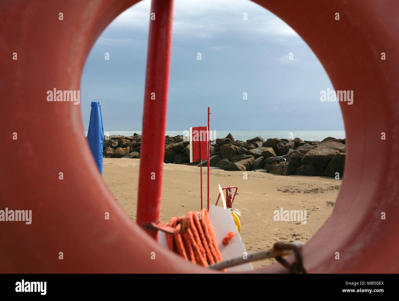 Beach safety items from red rescue donut - Stock Image