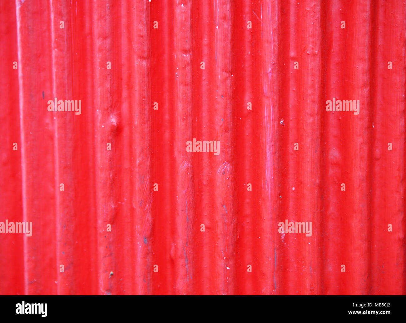 Red Corrugated Aluminium Sheet - Stock Image