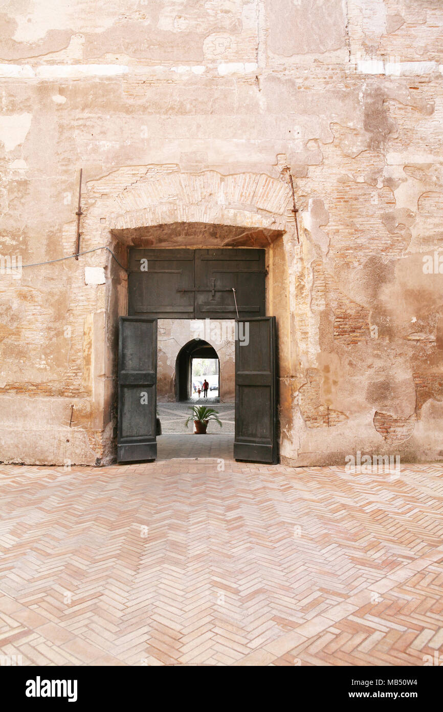 The door between the courtyards at Augustinian Monastery, Rome, Italy - Stock Image
