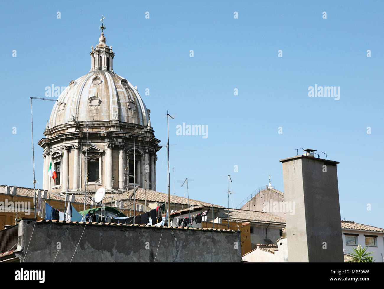 St. Andrea della Valle church dome with Italian flag and laundry line, Rome, Italy - Stock Image