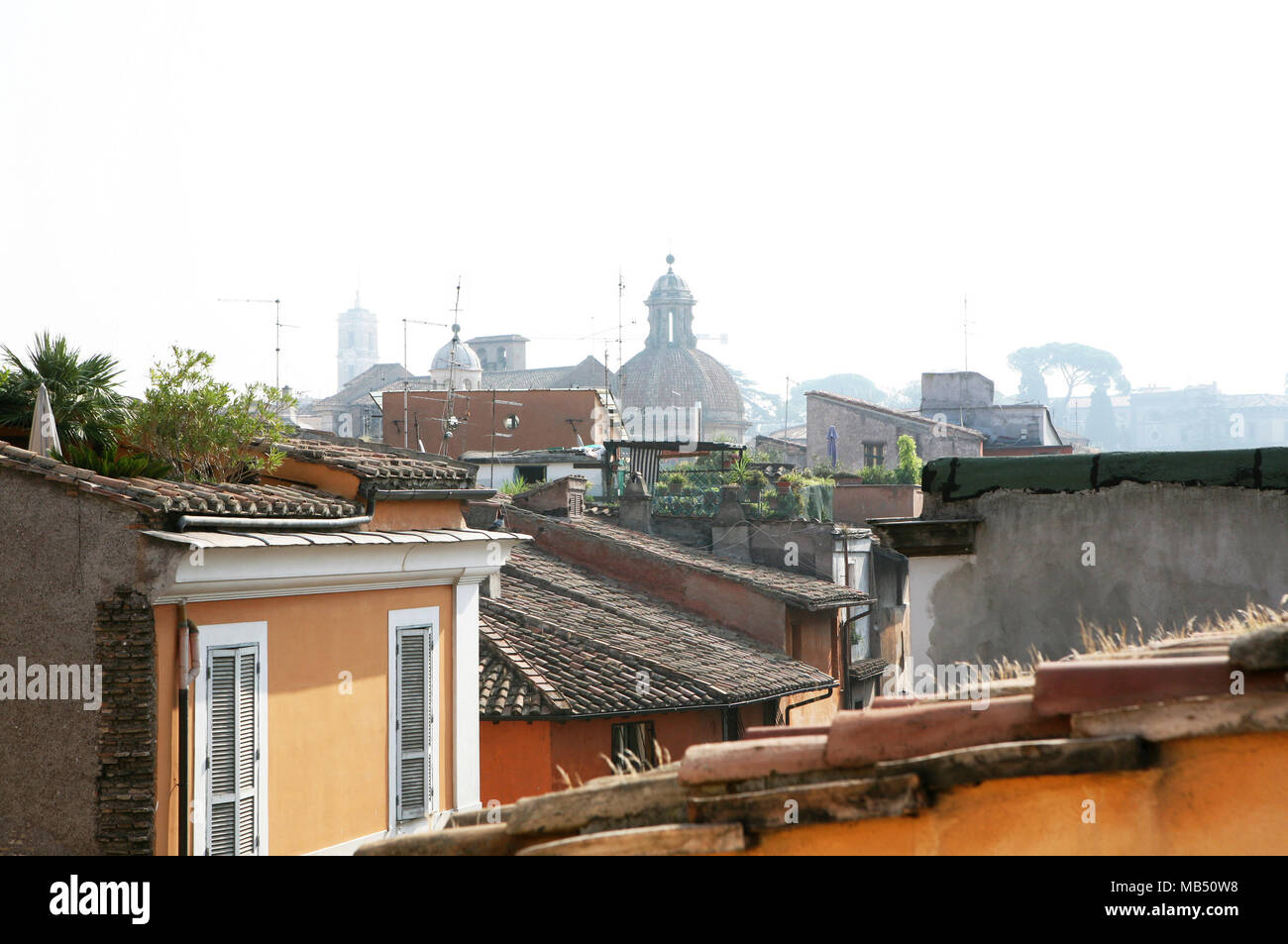Landscape on the roofs and domes with Capitol Hill Tower, Rome, Italy - Stock Image
