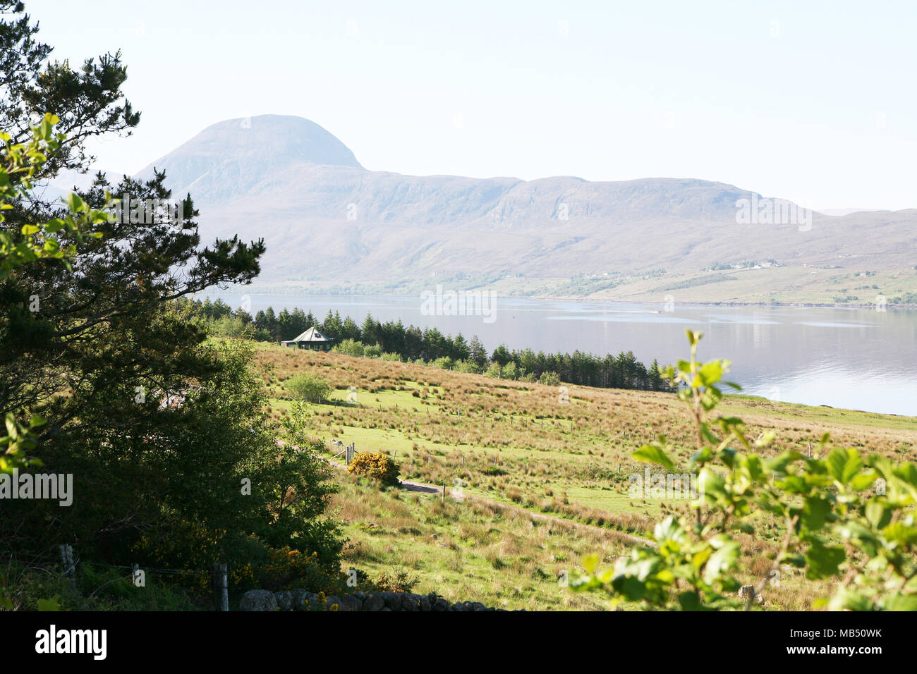 Landscape on ocean fjord and mountains, Ullapool, Scotland - Stock Image