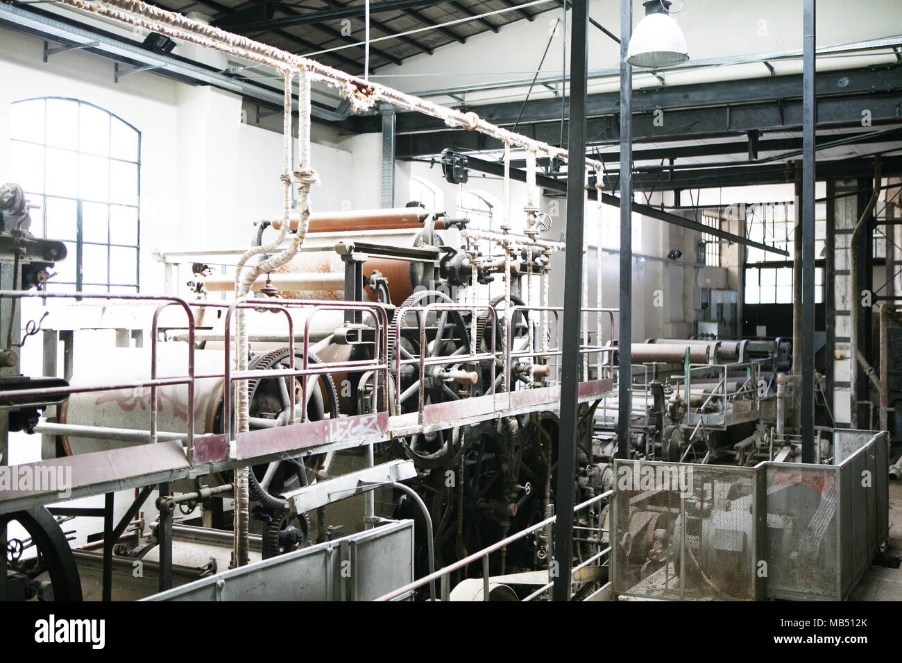 Old run down industrial paper plant machinery - Stock Image