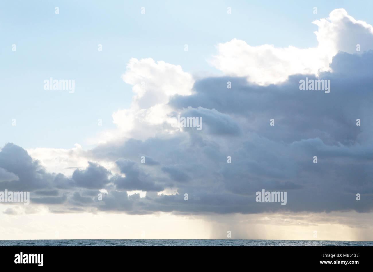 Storm rain cloud over the sea - Stock Image