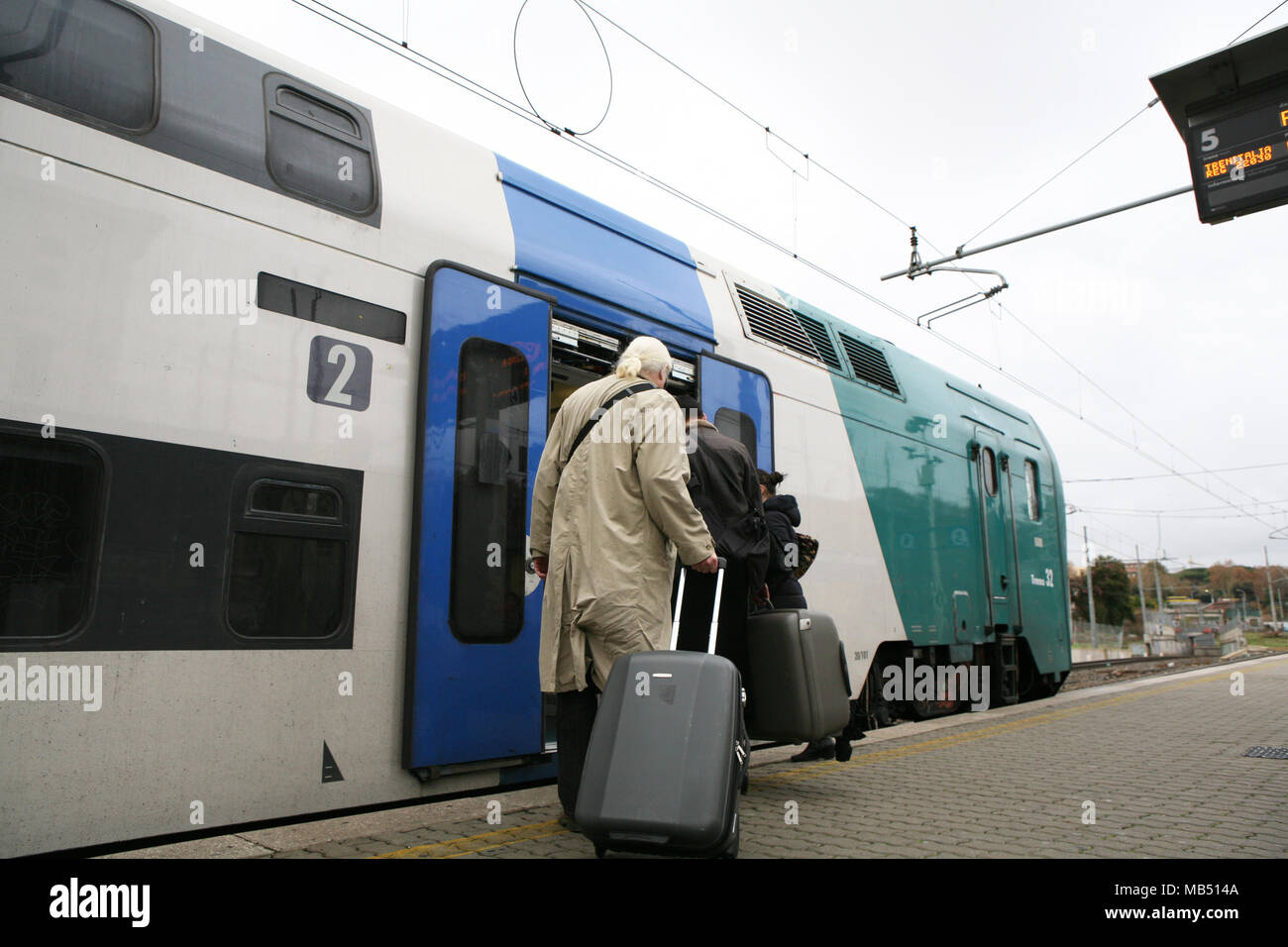 Passengers boarding the shuttle train to Fiumicino in Trastevere railway station, Rome, Italy - Stock Image