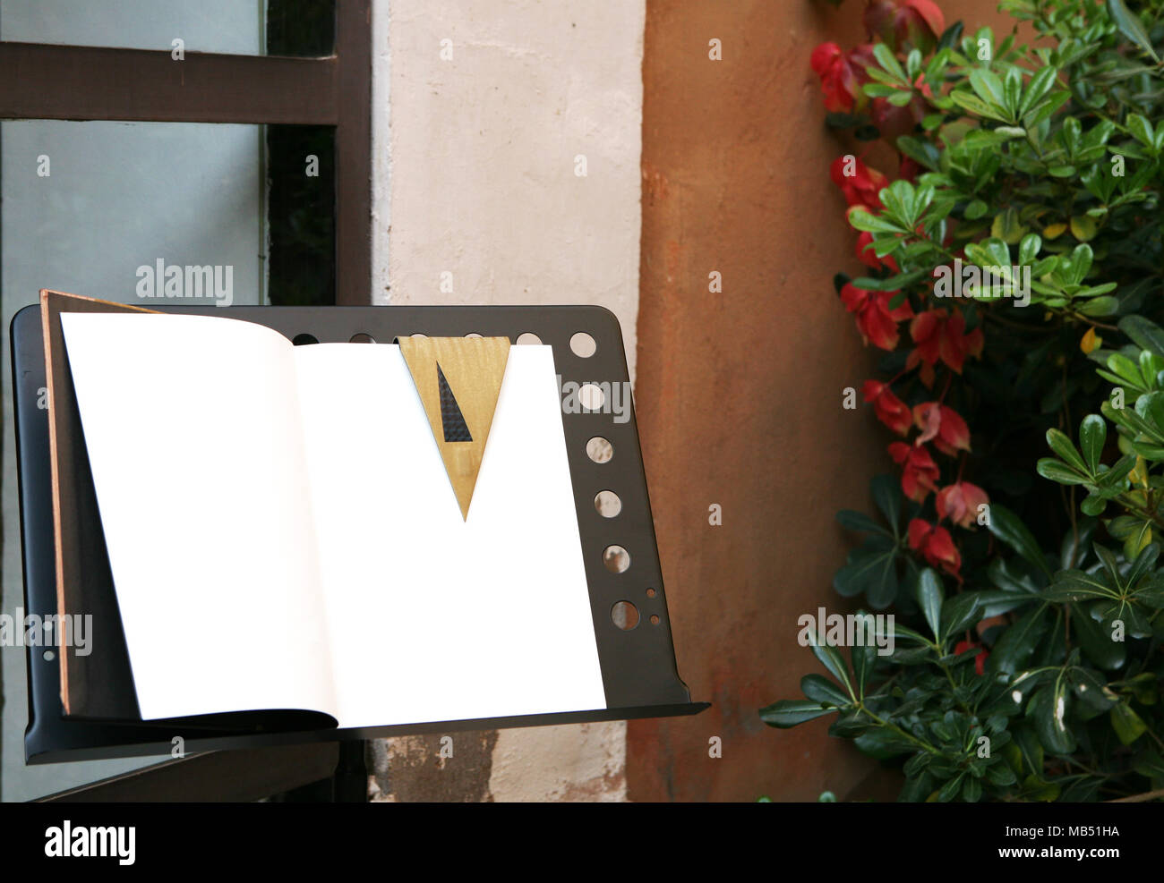 Open guests book on a lectern Stock Photo