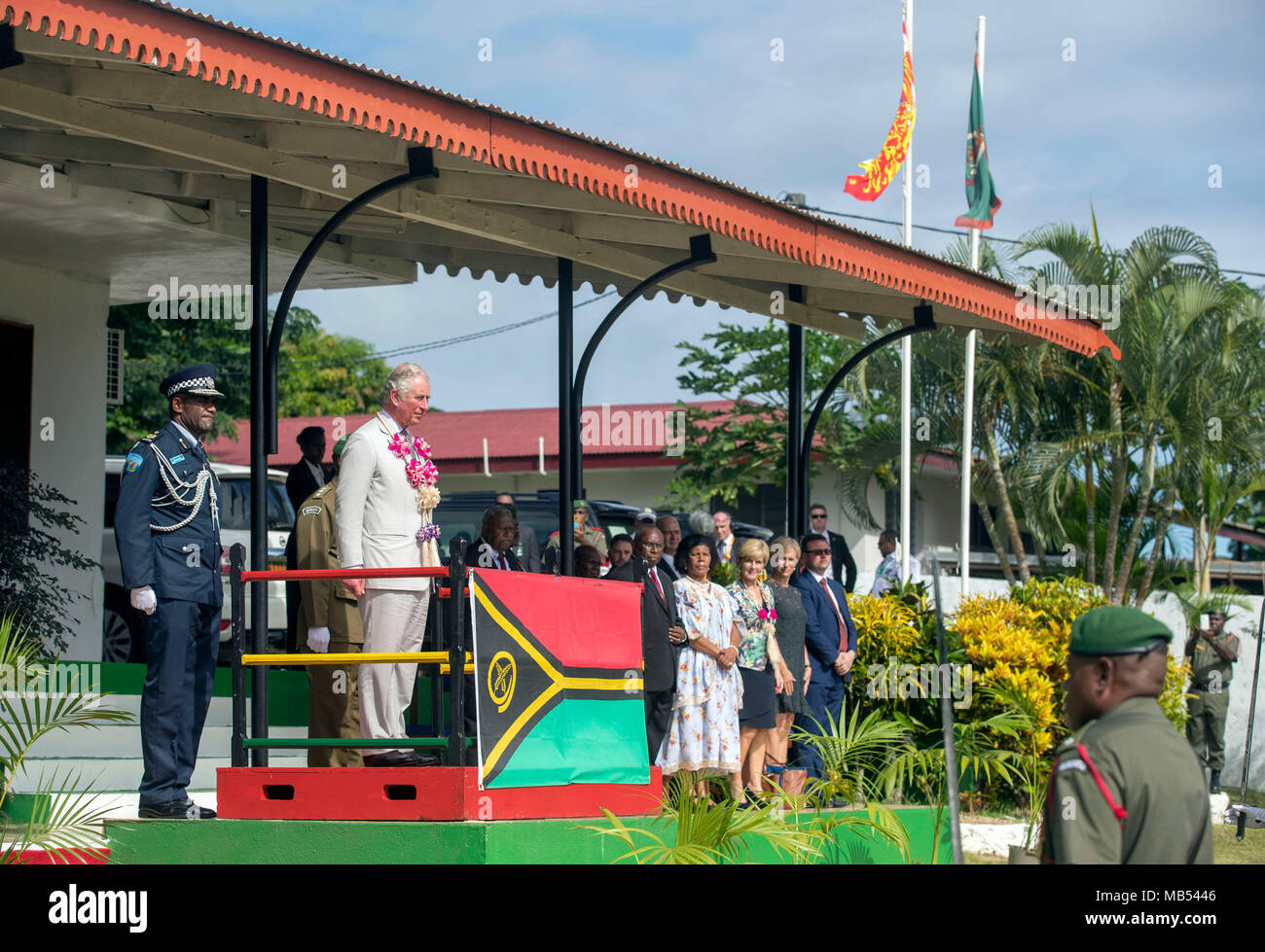 The Prince of Wales inspects a Guard of Honour, watched by His Excellency Obed Moses Tallis, President of Vanuatu and his wife Estelle Tallis (left of front row), as he visits the South Pacific island of Vanuatu, during his tour of the region. - Stock Image