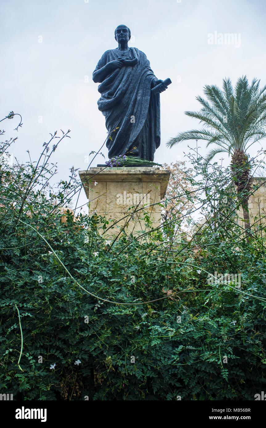 Bronze Statue of Seneca the Younger between jasmine garden, Roman Stoic philosopher. Cordoba, Spain - Stock Image
