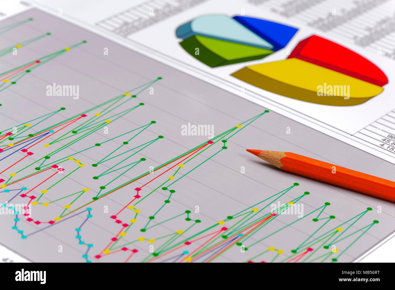 pencil laying on financial business chart Stock Photo