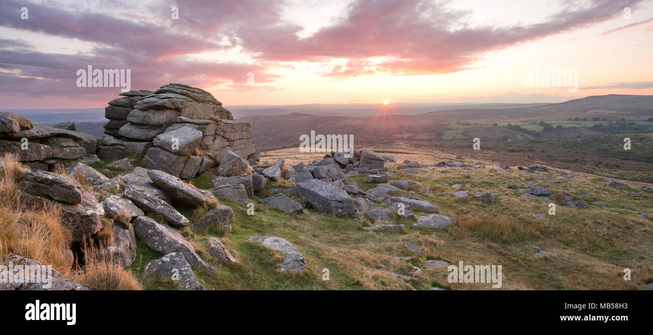 Vivid sunset on King's Tor Dartmoor National Park Devon UK - Stock Image