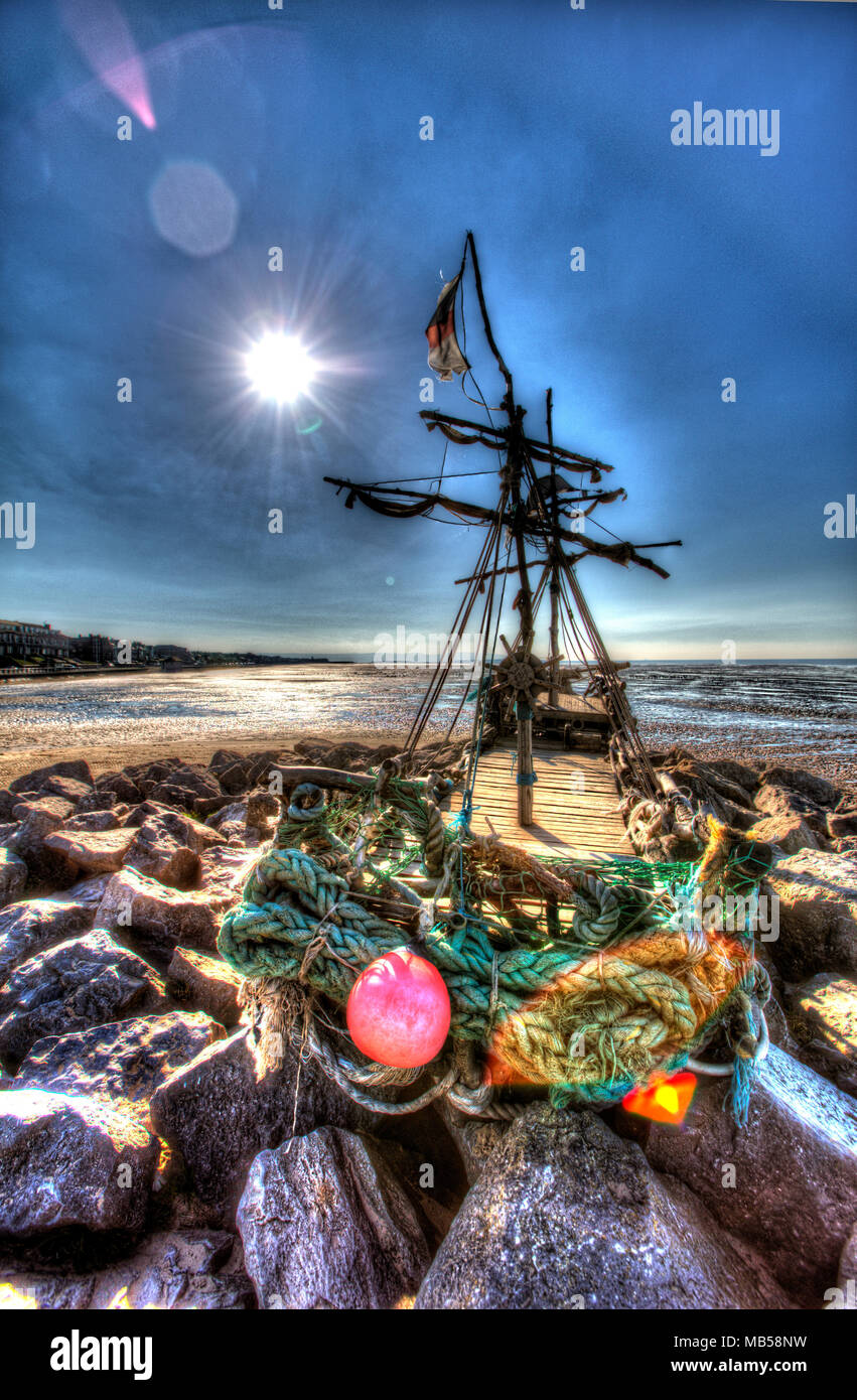 Wirral Peninsula, England. Artistic silhouetted view of the Grace Darling pirate ship on the shores of Hoylake. - Stock Image