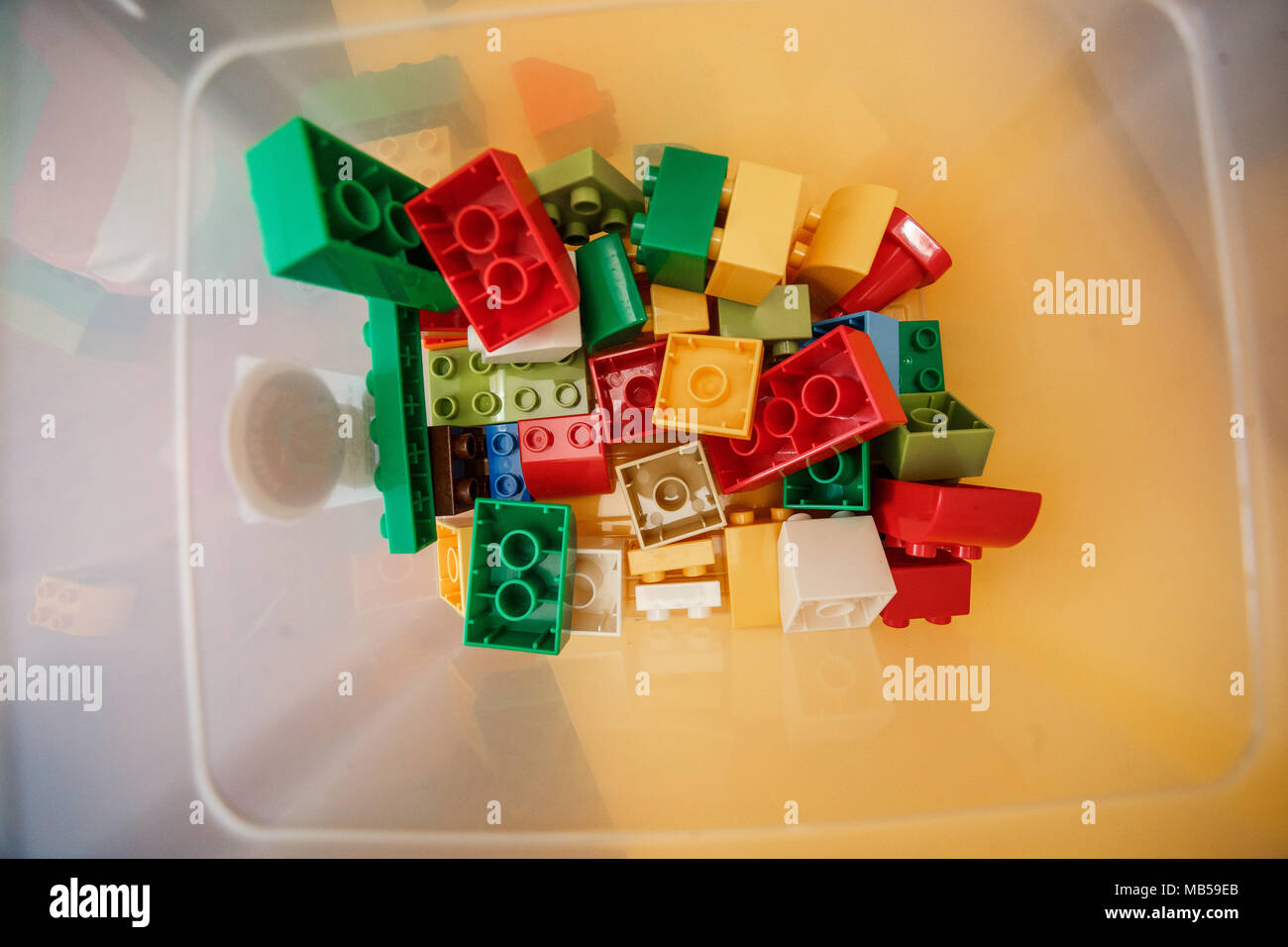 Colorful plastic constructor for children in the box. Top view. - Stock Image