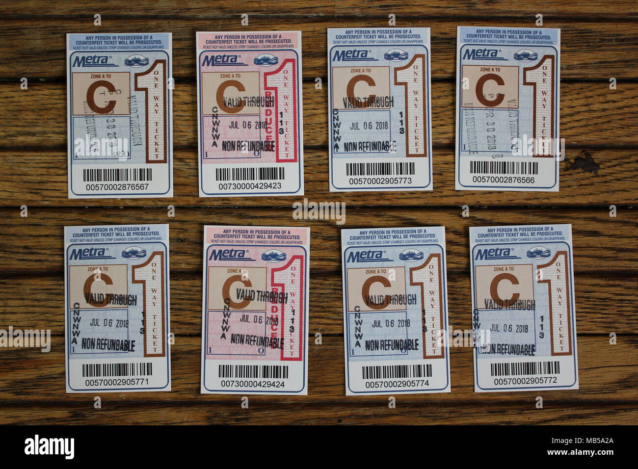 Punched and used Metra train tickets - Stock Image