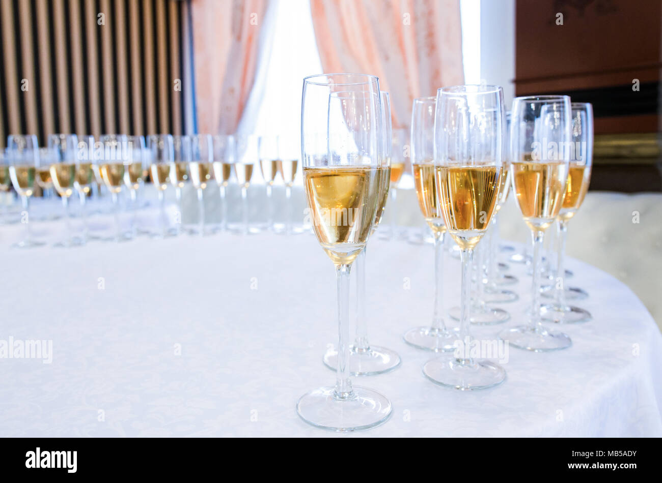 Champagne in the glases on the buffet table - Stock Image