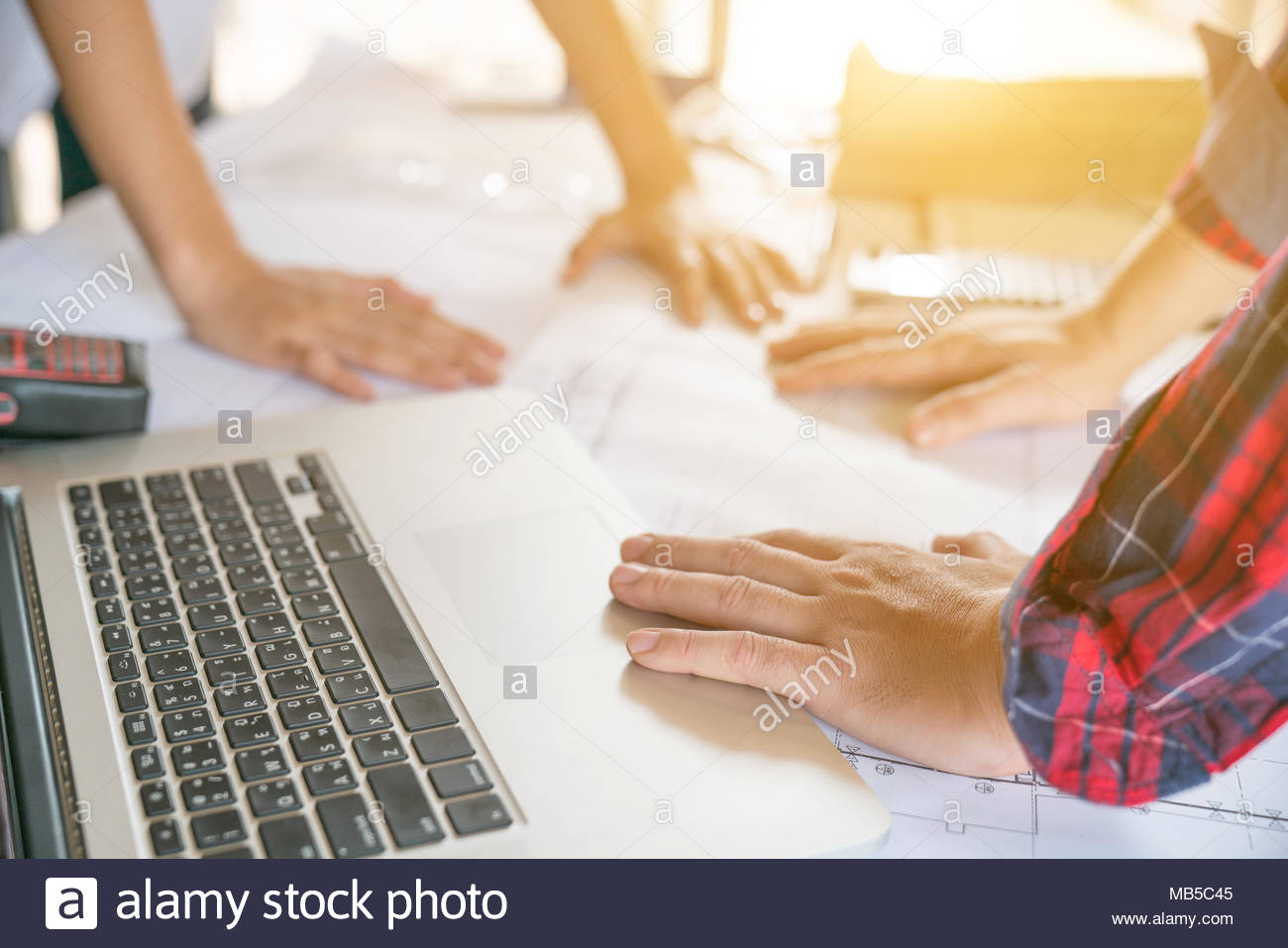engineer people meeting working and pointing at a drawings in office for discussing. Engineering tools and construction concept. - Stock Image