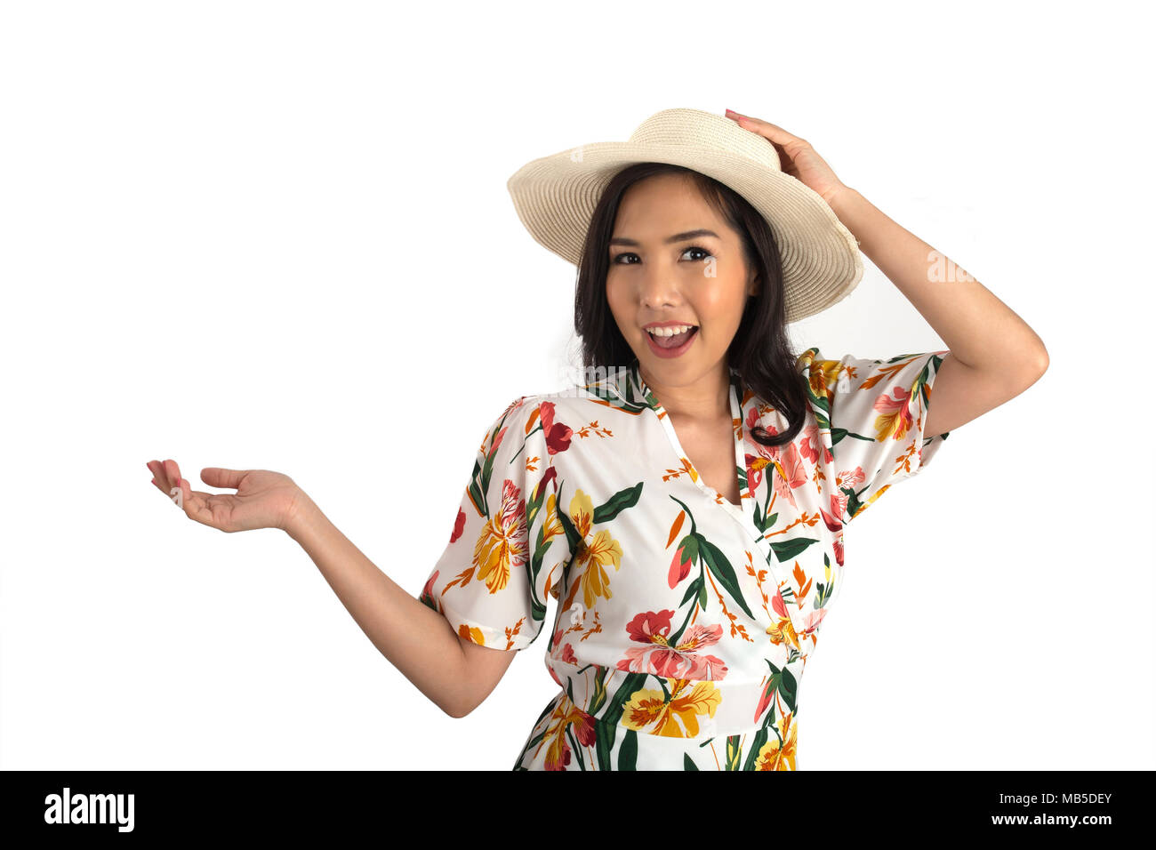 9d8afaed Half shot photo of pretty girl wearing floral dress put one hand on white  straw hat in studio. Yunyong Ampawa / Alamy Stock Photo