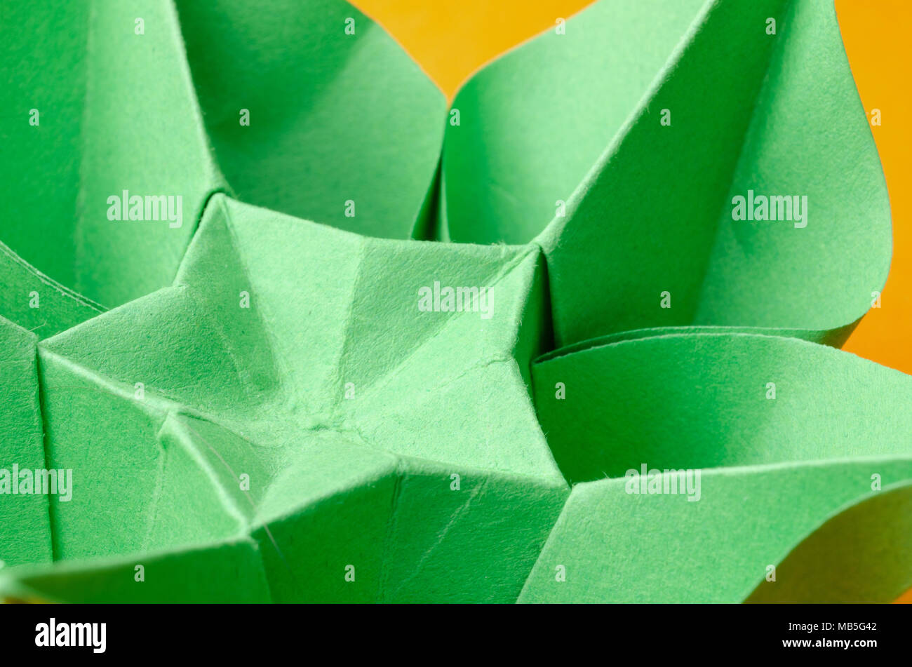 Closeup of a green paper origami flower with star shape stock photo closeup of a green paper origami flower with star shape mightylinksfo Images