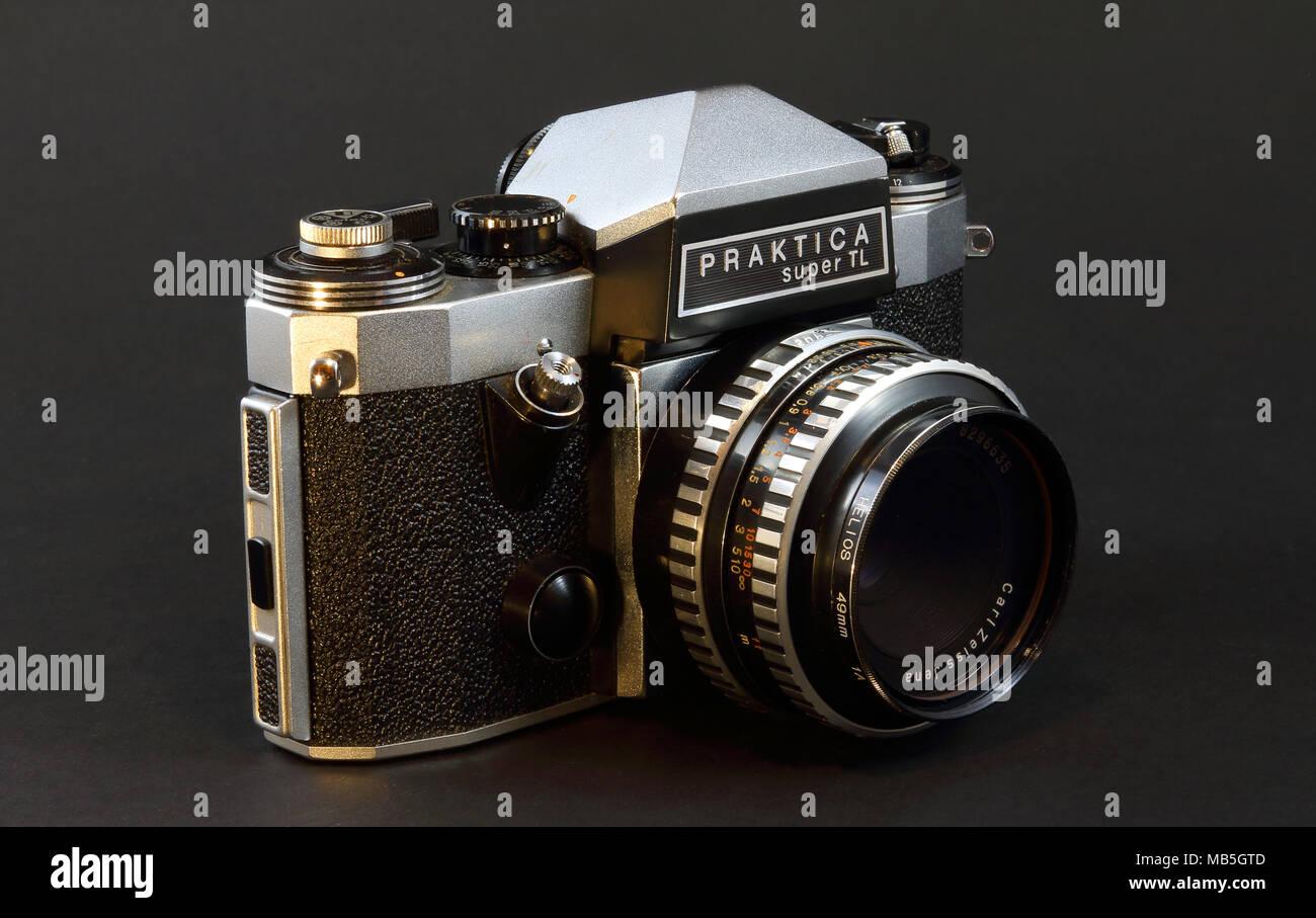 Praktica film camera on blackbackground - Stock Image
