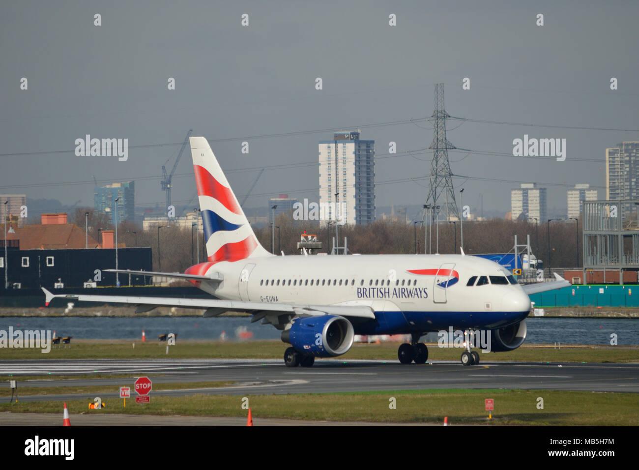 British Airways Airbus 318 aircraft taxiing at London City Airport - Stock Image