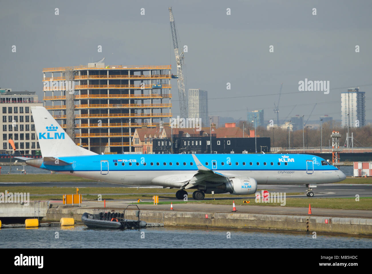 KLM Cityhopper Embraer 190 aircraft taxiing at London City Airport - Stock Image
