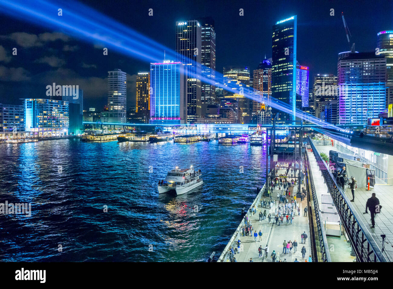 The 'Vivid Sydney' Festival takes place on Sydney Harbour in Sydney, Australia. The popular annual event, held on the shores of Sydney Harbour and previously known as the Vivid Festival, runs from May 26 to June 17, 2017. Pictured: Circular Quay seen from the Overseas Passenger Terminal. - Stock Image